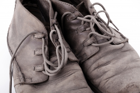 Pair of old leather boots isolated on the white background photo