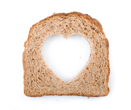 Piece of bread toast cut hole in shape of heart Isolated on white background Stock Photo - 14365061