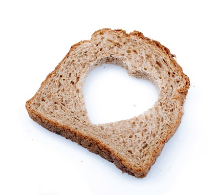 Piece of bread toast cut hole in shape of heart Isolated on white background Stock Photo - 14365049