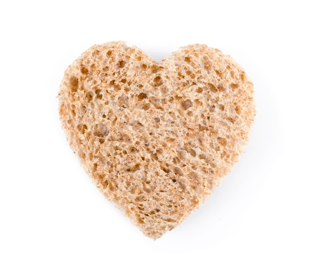 Piece of bread toast cut in shape of heart isolated on white background Stock Photo