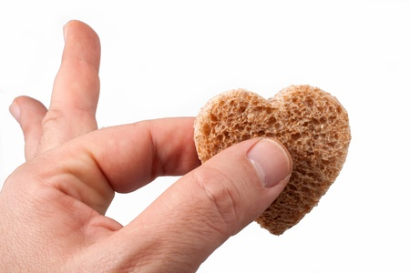 Food with love - helping the poor concept. Ηands holding a heart of bread Stock Photo - 14365047