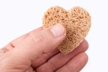 needy: Food with love - helping the poor concept. Ηands holding a heart of bread
