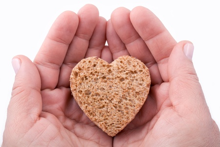 Food with love - helping the poor concept. Ηands holding a heart of bread Stock Photo - 14365162