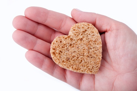 Food with love - helping the poor concept. Ηands holding a heart of bread Stock Photo - 14365102