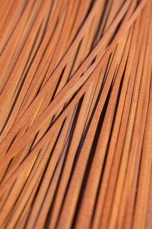 Background texture of rusty steel rods used in construction to reinforce concrete