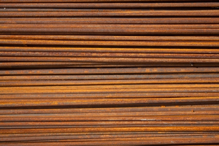 Background texture of rusty steel rods used in construction to reinforce concrete photo