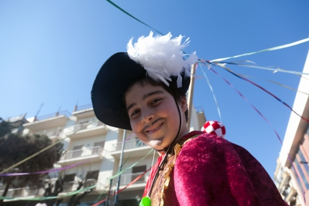 ALEXANDROUPOLIS, GREECE - FEB 25: Unidentified participant of carnival parade in Alexandroupolis on February 25, 2012 in Evros, Alexandroupolis, Greece. Group of people dressed in carnival costumes