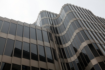 Modern building with rounded corners made of glass and metal photo