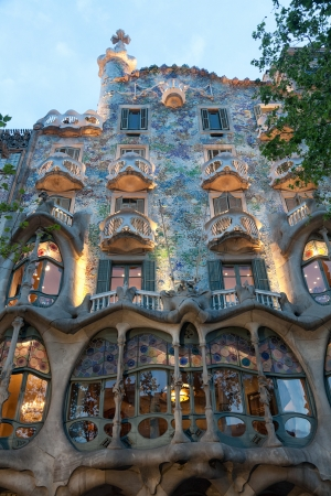 BARCELONA - APRIL 14: The facade of the house Casa Battlo (also could the house of bones) designed by Antoni Gaudi with his famous expressionistic style on April 14, 2012 in Barcelona, Spain Editorial