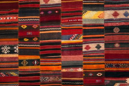 Greek traditional patchwork fabric handmade, in tonnes of orange Stock Photo