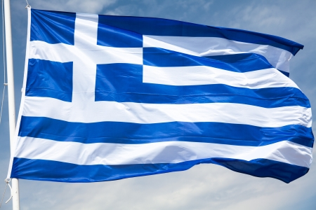 National flag of Greece waving over blue sky photo