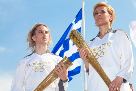 thessaloniki: THESSALONIKI, GREECE - MAY 13: Yiota Oikonomou and Ioannis Melissanidis seen here in Thessaloniki as they welcome the Olympic torch on May 13, 2012 in Thessaloniki, Greece. The event took place in front of the White Tower Editorial