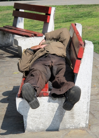 THESSALONIKI, GREECE - MARCH 29: Sleeping homeless man on the bench in a public park on March 29, 2012 in Thessaloniki, Greece. Increase of 25% of the homeless in years 2009-2011 in Greece