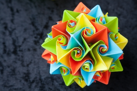 Closeup of big origami star flowers from paper with selective focus photo