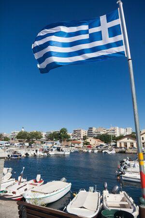 kreta: ALEXANDROUPOLIS, GREECE - AUGUST 18: Sailboats at marina dock with Greek flags on August 18, 2012 in Alexandroupolis, Greece