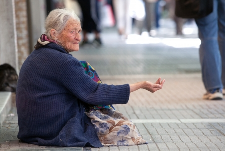 THESSALONIKI, GREECE - JUNE 28: The number of beggars in the city has increased dramatically. The economic crisis has hit the elderly on June 28, 2011 in Thessaloniki, Greece Stock Photo - 15619789