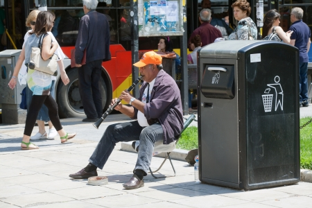 THESSALONIKI, GREECE - JUNE 28: The number of street musicians in the city has increased dramatically. The economic crisis has hit the elderly on June 28, 2011 in Thessaloniki, Greece