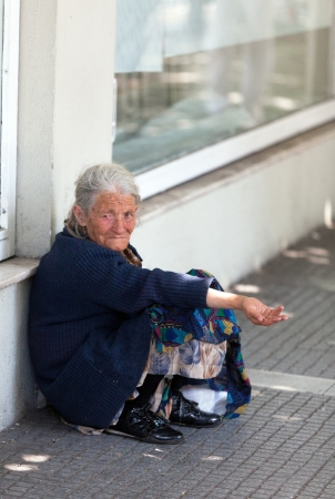 thessaloniki: THESSALONIKI, GREECE - JUNE 28: The number of beggars in the city has increased dramatically. The economic crisis has hit the elderly on June 28, 2011 in Thessaloniki, Greece