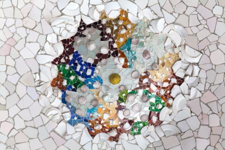 BARCELONA, SPAIN - APRIL 16: Colorful mosaic in famous Parc Guell on April 16, 2012 in Barcelona, Spain. It is part of the UNESCO World Heritage Site Works of Gaudi, major Spanish landmark.