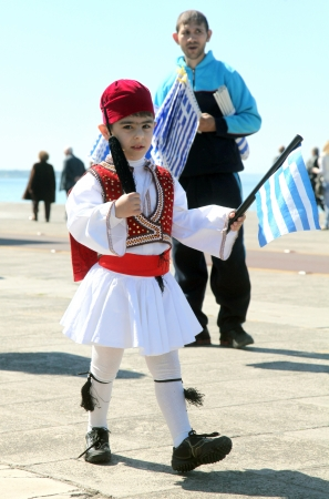 THESSALONIKI, GREECE - MARCH 25: Unidentified kids on 25th of each March a parade is held for the anniversary of Greek revolution against Turkish occupation on March 25, 2012 in Thessaloniki, Greece.  Editorial