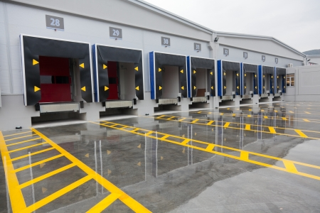 commercial docks: Loading dock cargo doors at big warehouse Stock Photo