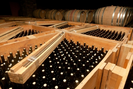 alcohol cardboard: Packaged bottles of wine in large wooden crates Stock Photo