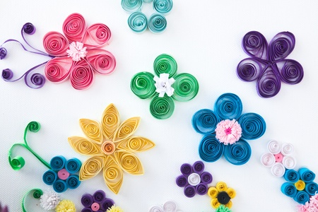Flowers made ​​of paper in different colors on a white background  Stock Photo