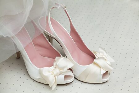 shop tender: Bridal clothing and accessories. Wedding shoes