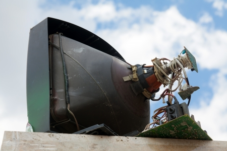 cathode ray tube: Back of old television cathode tube on sky with clouds Stock Photo