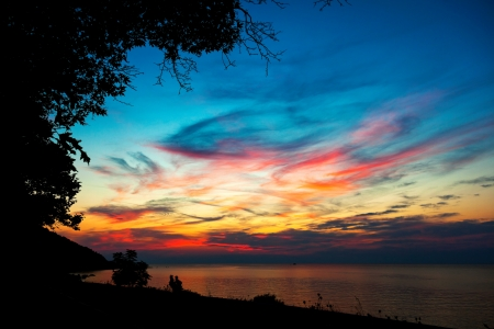 Amazing nature background - dramatic and moody orange, red and blue cloudy sunset sky shot horizontal. photo