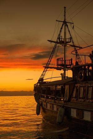 Old Fashion Sail Boat near Harbor at Sunset in Thessaloniki - Greece