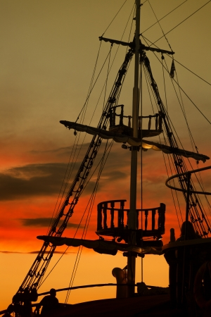 Old Fashion Sail Boat near Harbor at Sunset in Thessaloniki - Greece photo