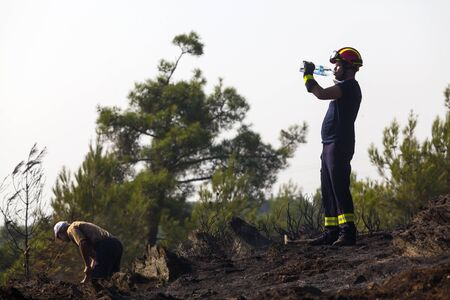 THESSALONIKI, GREECE - AUGUST 26: Fire department in action at a Seich Sou forest low scale fire on August 26,2011 in Thessaloniki, Greece.