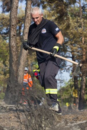 THESSALONIKI, GREECE - AUGUST 26: Fire department in action at a Seich Sou forest low scale fire on August 26,2011 in Thessaloniki, Greece. Stock Photo - 16768201