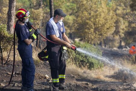 low scale: THESSALONIKI, GREECE - AUGUST 26: Fire department in action at a Seich Sou forest low scale fire on August 26,2011 in Thessaloniki, Greece. Editorial