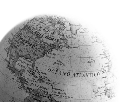 Part of a globe with map of Atlantic Ocean and America isolated on white background photo