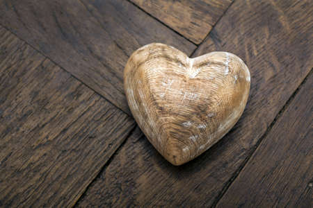 Wooden heart on an old wooden table photo