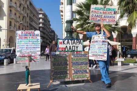 demonstrator: THESSALONIKI, GREECE - OCTOBER 26: Portrait of unidentified senior protesting for austerity measures in Aristotle Square on October 26, 2012 in Thessaloniki, Greece