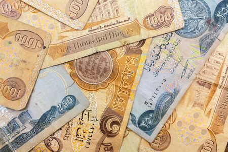 reevaluation: Close up of iraqi dinar notes