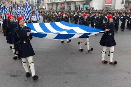 THESSALONIKI, GREECE - OCT 27:100th liberation anniversary from the City?s 500 years Ottoman Empire Occupation; flown of the Greek flag on the White Tower on Oct 27, 2012 in Thessaloniki, Greece Stock Photo - 17465204