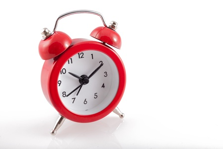 Alarm Clock  Classic red old style alarm clock isolated on white Stock Photo