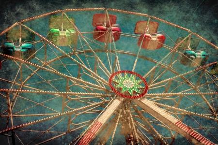 Texture Vintage Ferris Wheel Carnival silhouette over sun Stock Photo