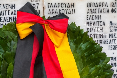 heros: German laid wreath to the memory of the victims at Chortiatis village in Thessaloniki (Greece) that were burned during the German occupation on 291944