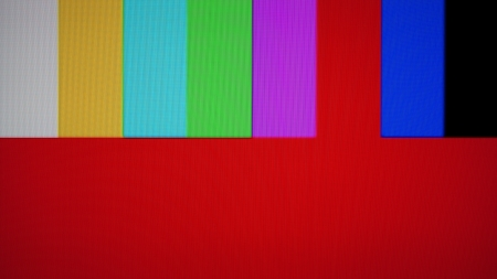 SMPTE color bars is a television test pattern used where the NTSC video standard is utilized. NTSC tv pattern signal for test purposes. Snapshots from real television screen  Stock Photo