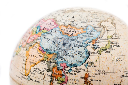 Part of a globe with map of China isolated on white background