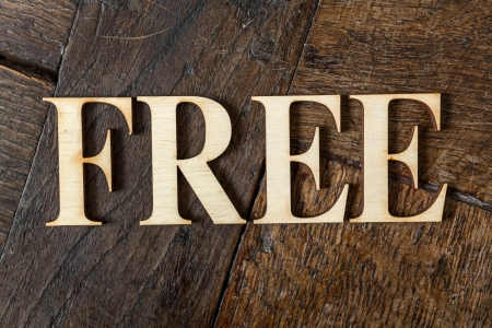 free plates: Wooden letters forming word FREE written on old vintage wooden plates  Stock Photo