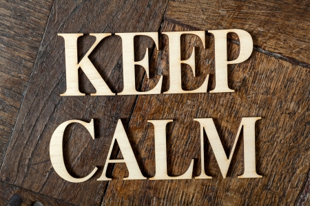 Wooden letters forming words KEEP CALM written on old vintage wooden plates  photo