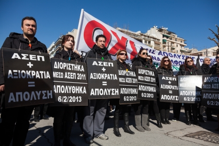 THESSALONIKI, GREECE - FEB 20: Dismissed public servants protest against austerity measures and memorandum, in front of the Labour Centre of Thessaloniki on Feb 20, 2013 in Thessaloniki, Greece.   Editorial