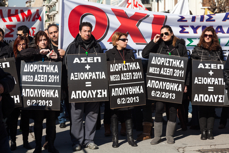 THESSALONIKI, GREECE - FEB 20: Dismissed public servants protest against austerity measures and memorandum, in front of the Labour Centre of Thessaloniki on Feb 20, 2013 in Thessaloniki, Greece.