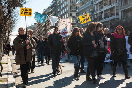 public servants: THESSALONIKI, GREECE - FEB 20: Dismissed public servants protest against austerity measures and memorandum, in front of the Labour Centre of Thessaloniki on Feb 20, 2013 in Thessaloniki, Greece.   Editorial